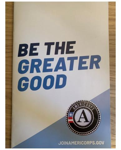 """First page of booklet has AmeriCorps logo with text """"Be the greater good"""""""