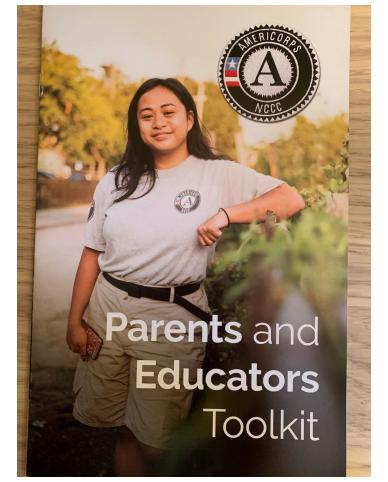 "First page of booklet contains photo of member leaning against truck bed with plants, AmeriCorps NCCC logo, and text ""Parents and Educators Toolkit"""
